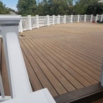 Tier Fencing's Deck Construction with White Fence