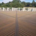 Tier Fencing's Large Deck Construction with White Fence